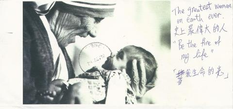 "Mother Teresa holding a baby. On the side the person has written ""The greatest woman on earth ever. Be the fire of my life""."