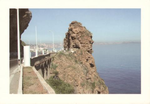 A big rock by a road along a cliff in Oran, Algerie.
